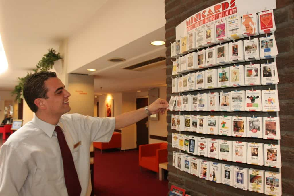 Concierge looking at Minicards wall display