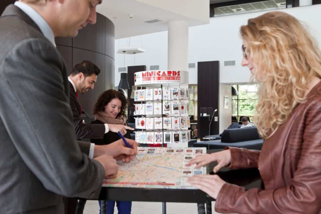 Hotel concierge and guests with Minicards DeskMap